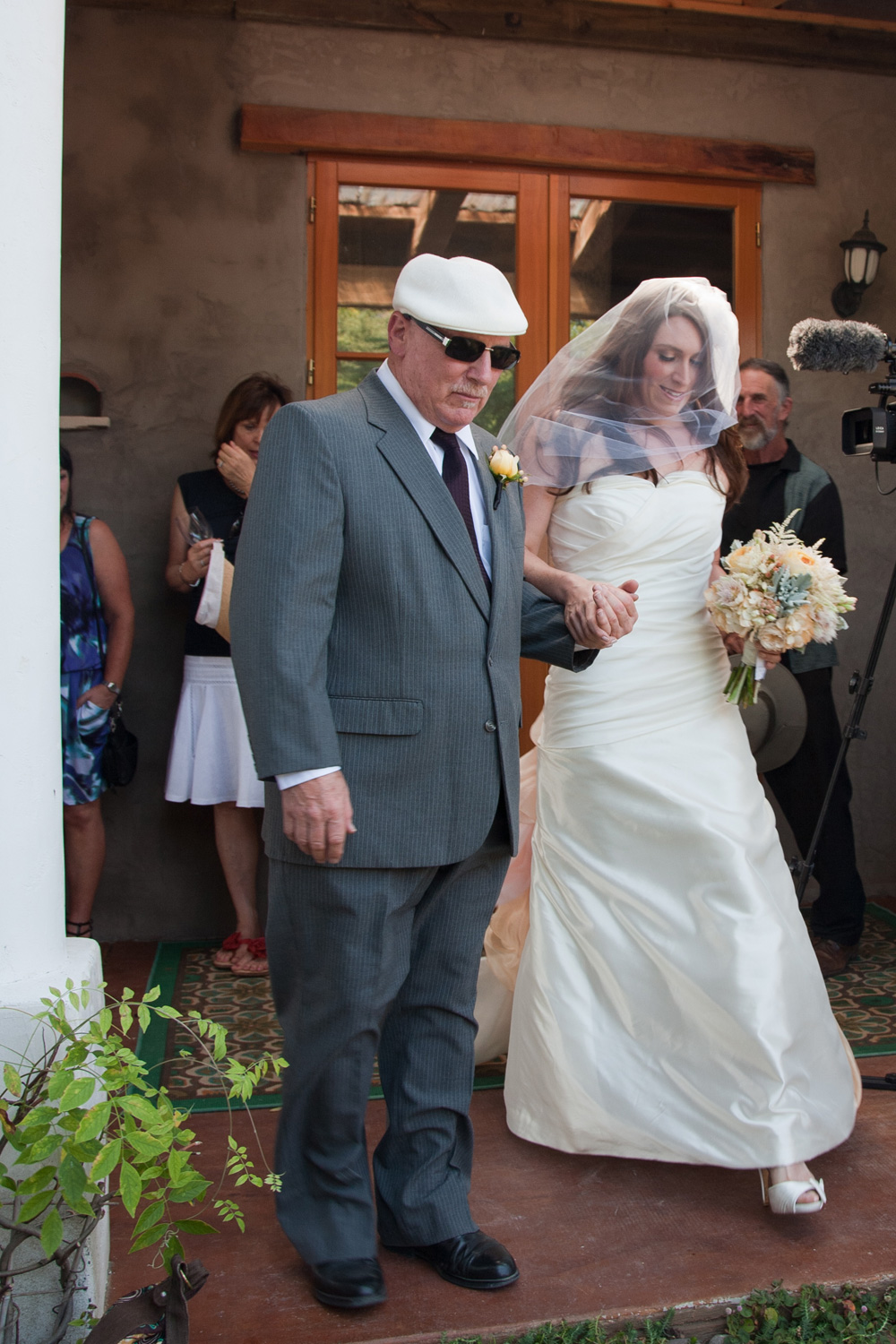 Allie's father walks her down the aisle